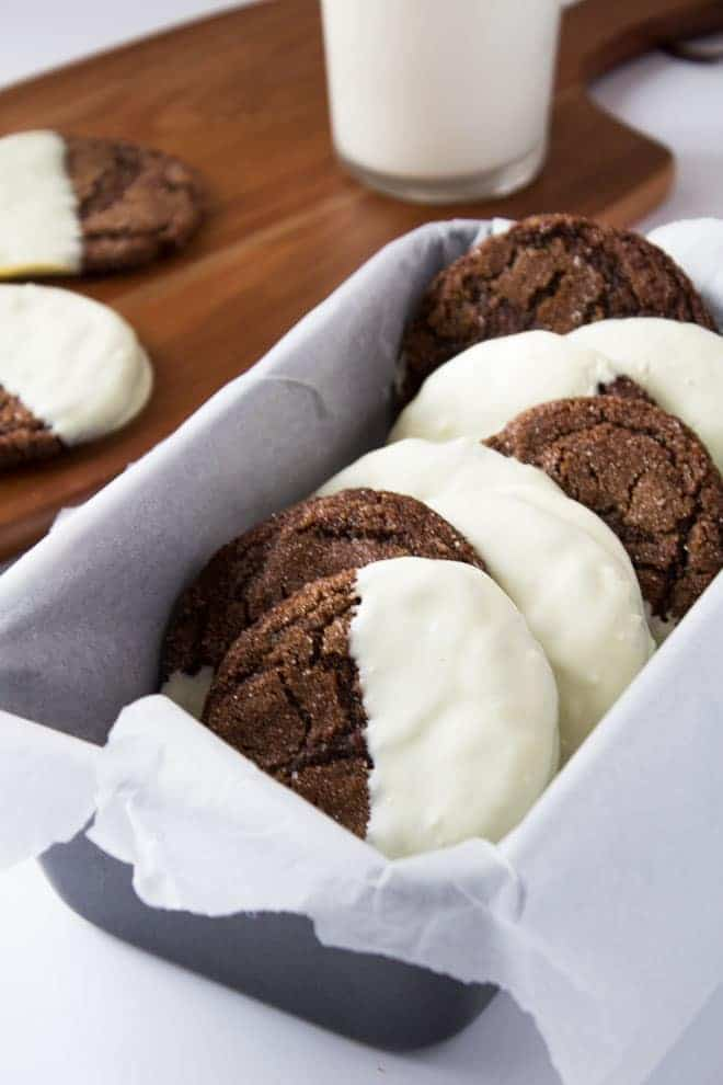 White Chocolate Dipped Ginger Cookies in a loaf pan lined with parchment paper.