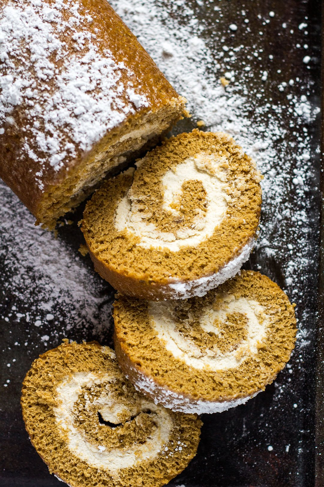 Gingerbread Cake Roll- Deliciously moist and fluffy gingerbread cake roll that is loaded with warm, cozy flavours, and filled with homemade spiced whipped cream! Recipe on marshasbakingaddiction.com