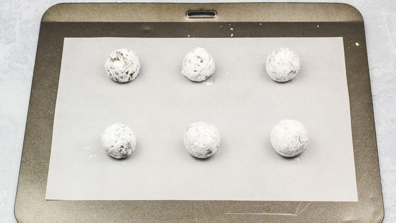 Cookie dough balls on baking tray ready to be baked.