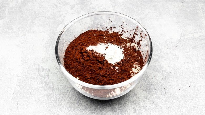Flour, cocoa powder, baking powder, and salt in a mixing bowl.