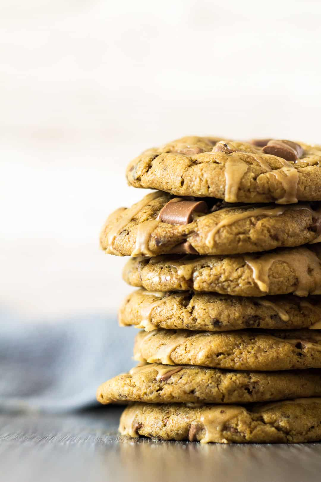 A close-up view of a tall stack of Chocolate Chip Coffee Cookies.