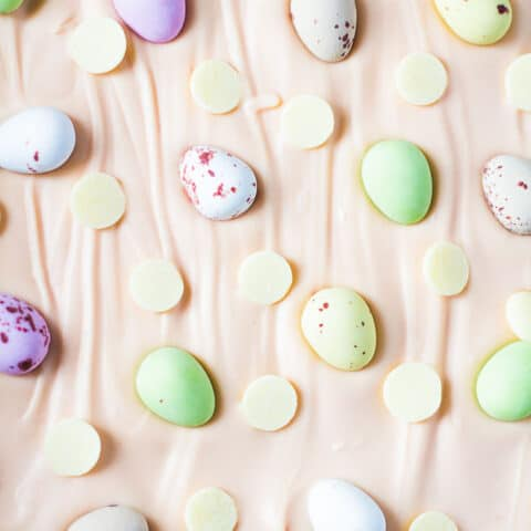 White Chocolate Easter Bark - A white chocolate layer topped with pink white chocolate, and studded with Cadbury Mini Eggs and white chocolate chips!