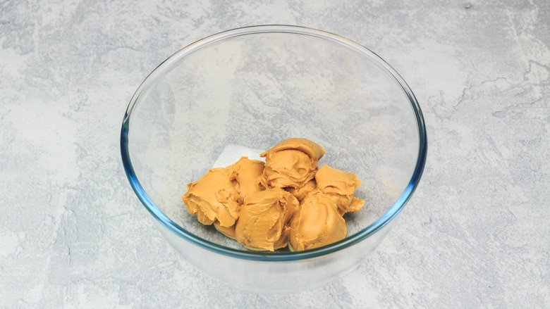 Peanut butter in a mixing bowl.