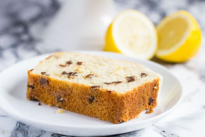 A slice of Chocolate Chip Lemon Bread served on a white plate.