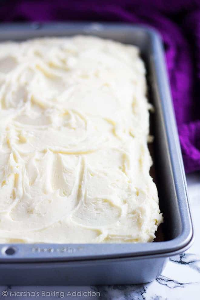 Perfect Vanilla Sheet Cake in a rectangle baking pan topped with vanilla frosting.