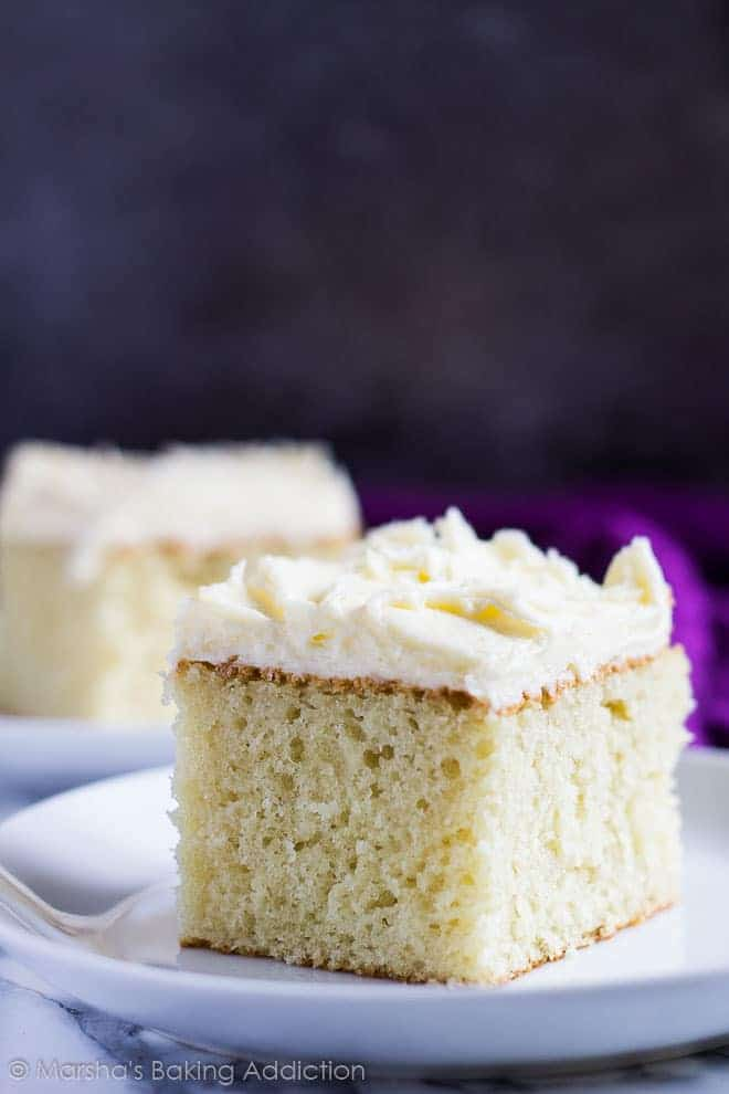 Perfect Vanilla Sheet Cake - Deliciously moist and fluffy vanilla cake baked in a rectangle pan, and topped with scrumptiously creamy vanilla buttercream frosting!