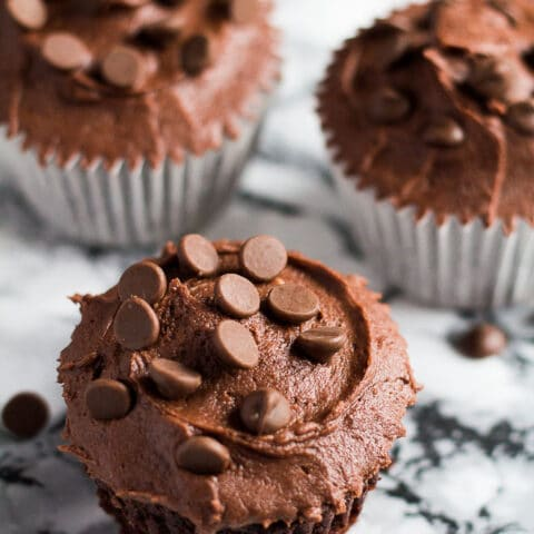 Double Chocolate Cupcakes -Deliciously moist and fluffy chocolate cupcakes stuffed with chocolate chips, and topped with a chocolate buttercream frosting!