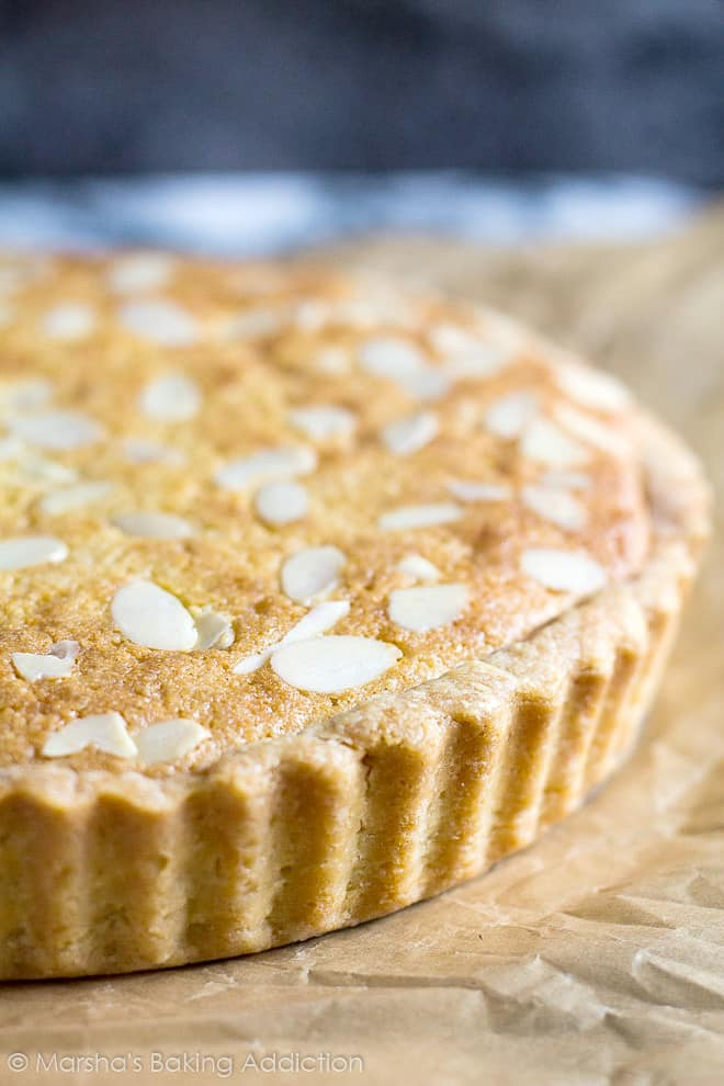 Close-up of the flaky, buttery crust on Bakewell Tart.