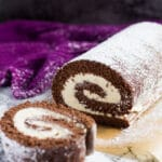 Chocolate Swiss Roll - Deliciously moist and fluffy cake filled with a thick layer of vanilla whipped cream and dusted with icing sugar!