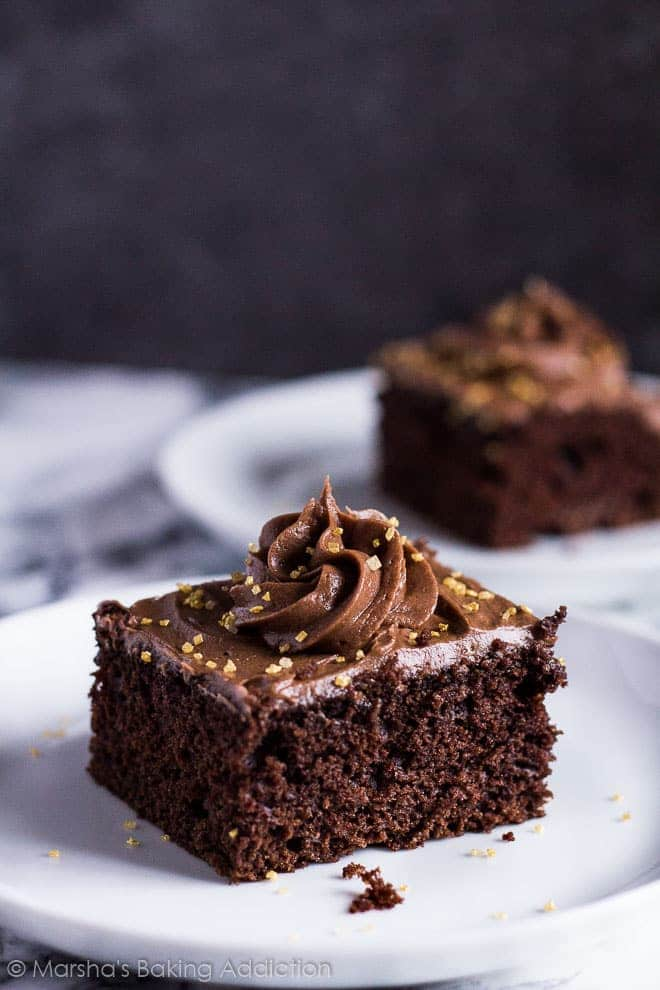 Chocolate Sheet Cake - A deliciously moist and fluffy chocolate cake spiced with cinnamon and topped with chocolate buttercream frosting!