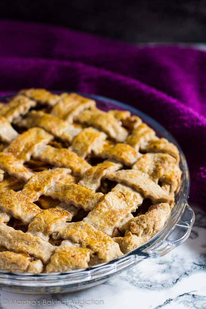 Homemade Apple Pie with lattice top in glass pie dish.