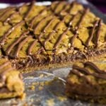 Nutella Stuffed Pumpkin Cookie Bars- These scrumptiously soft and chewy pumpkin cookie bars are spiced with autumn flavours, and stuffed full of Nutella!