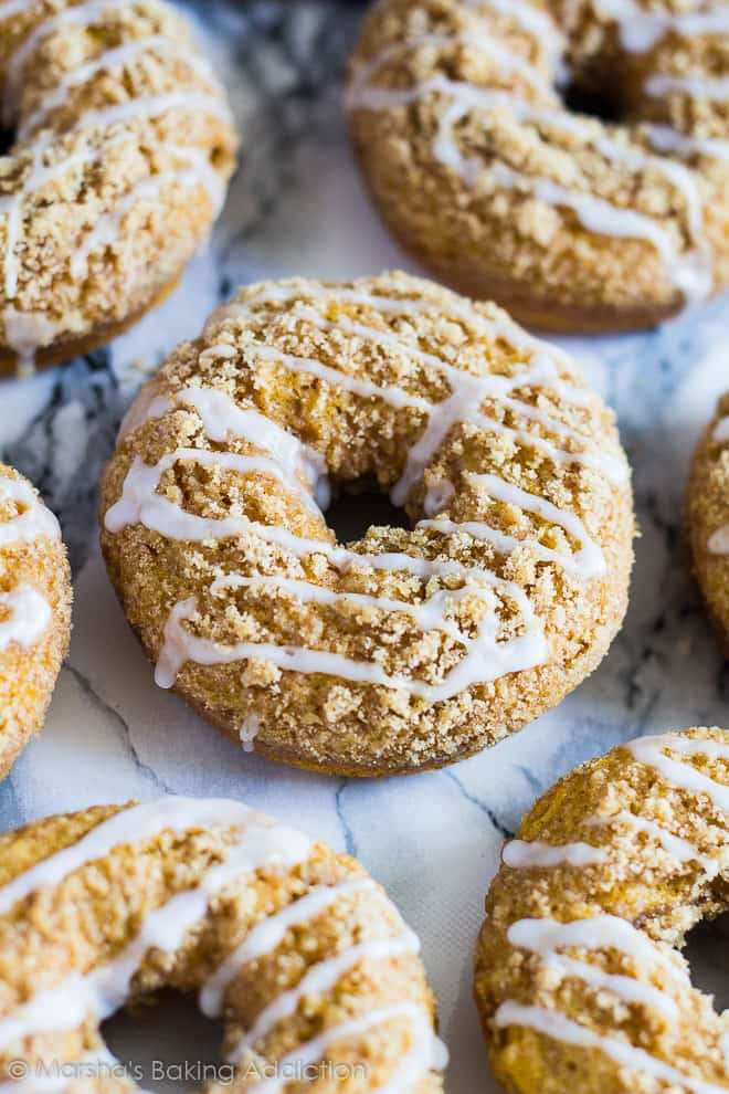Close-up of Baked Pumpkin Streusel Doughnuts on a marble background.