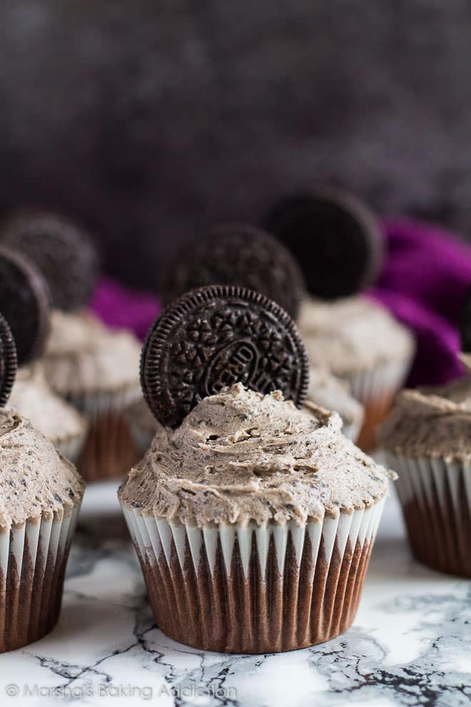 Frosted Chocolate Oreo Cupcakes on marble background.