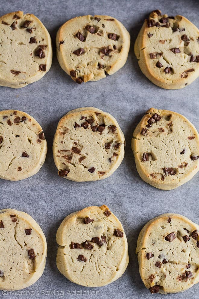 Overhead shot of Chocolate Chip Slice 'n' Bake Cookieson baking tray lined with parchment paper.
