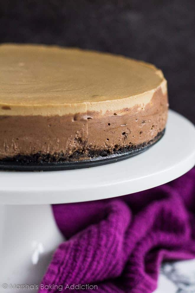 Close-up of Layered Mocha Cheesecake on a white cake stand.