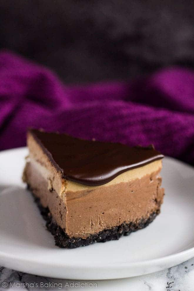 A slice of Layered Mocha Cheesecake served on a small white plate.