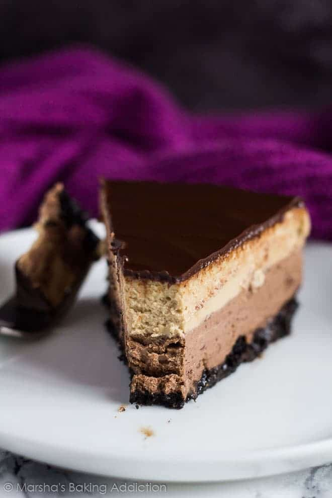 Slice of Layered Mocha Cheesecake served on small white plate with fork.