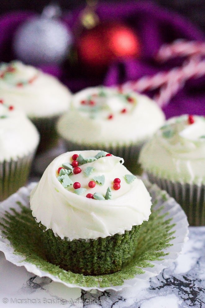 Green Velvet Cupcakes on marble background with wrapper peeled off.