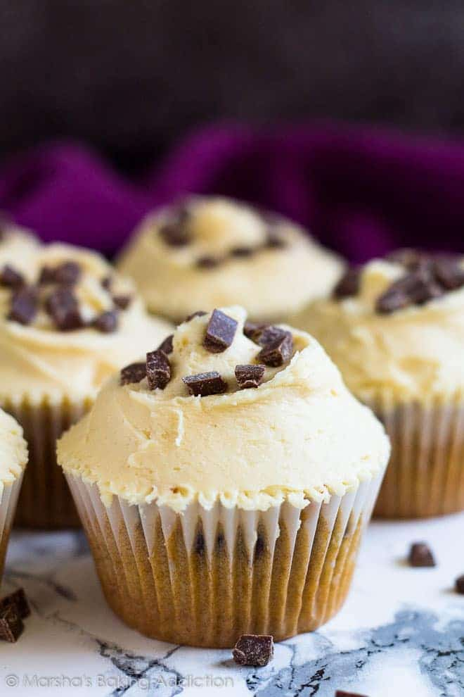 Chocolate Chip Peanut Butter Cupcakes - Deliciously moist and fluffy peanut butter cupcakes studded with chocolate chips, and topped with a creamy peanut butter frosting!