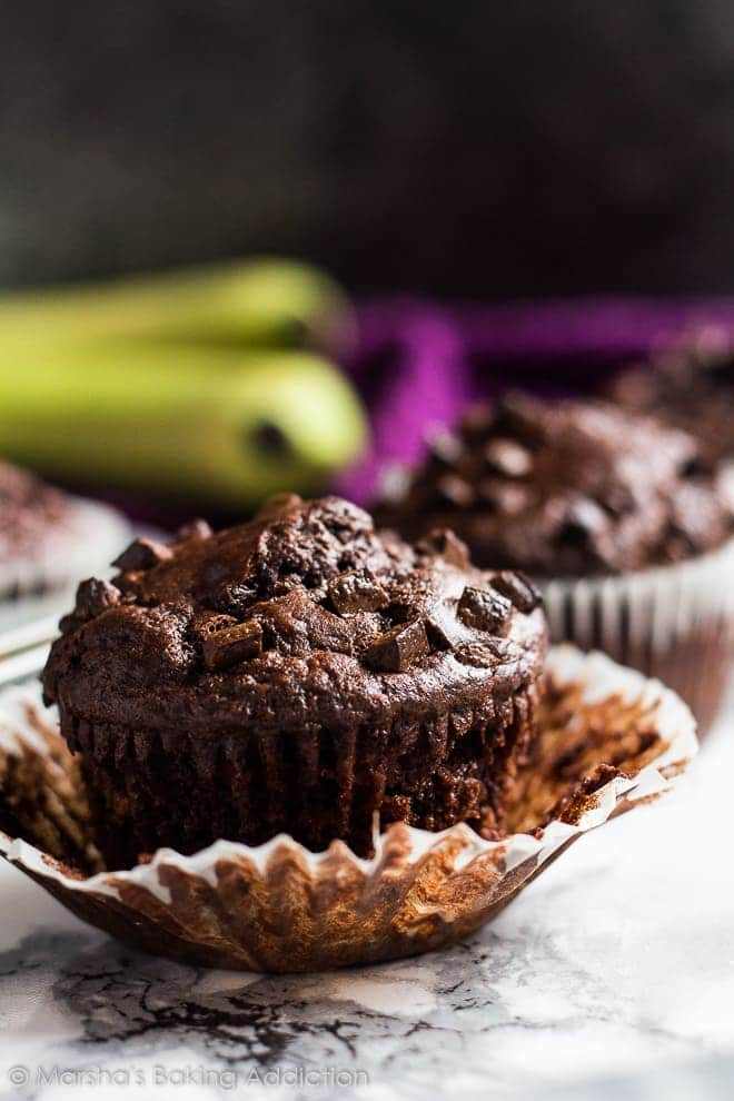 A chocolate banana muffin with wrapper peeled off.
