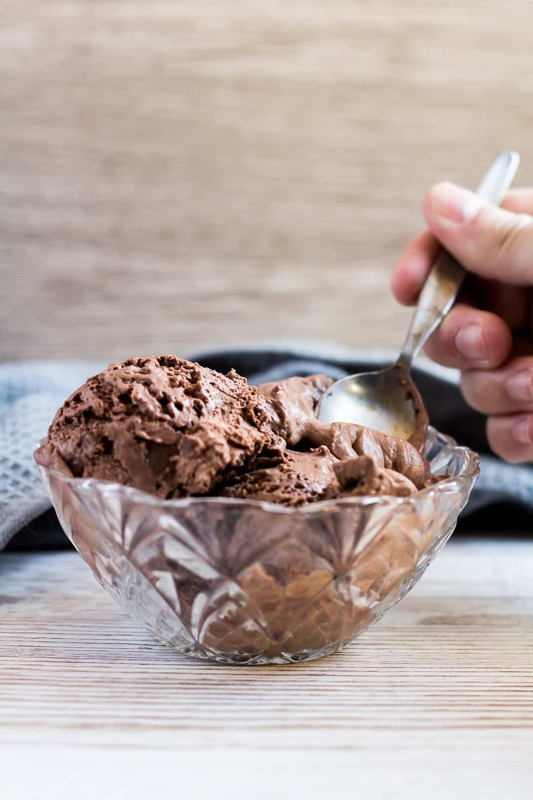 Scoops of No-Churn Double Chocolate Ice Cream in a small glass bowl with a spoon.