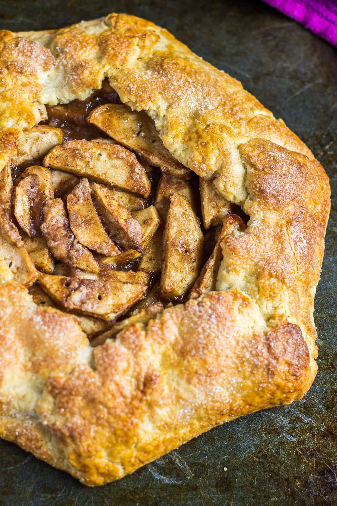 Overhead shot of a homemade apple galette on a baking tray.