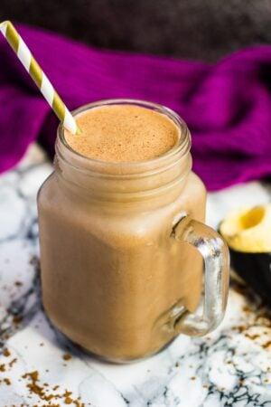 Nutella coffee milkshake in a mason jar with a straw.