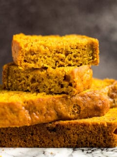 A close-up of a stack of pumpkin bread slices.