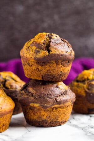 A stack of two pumpkin chocolate muffins.