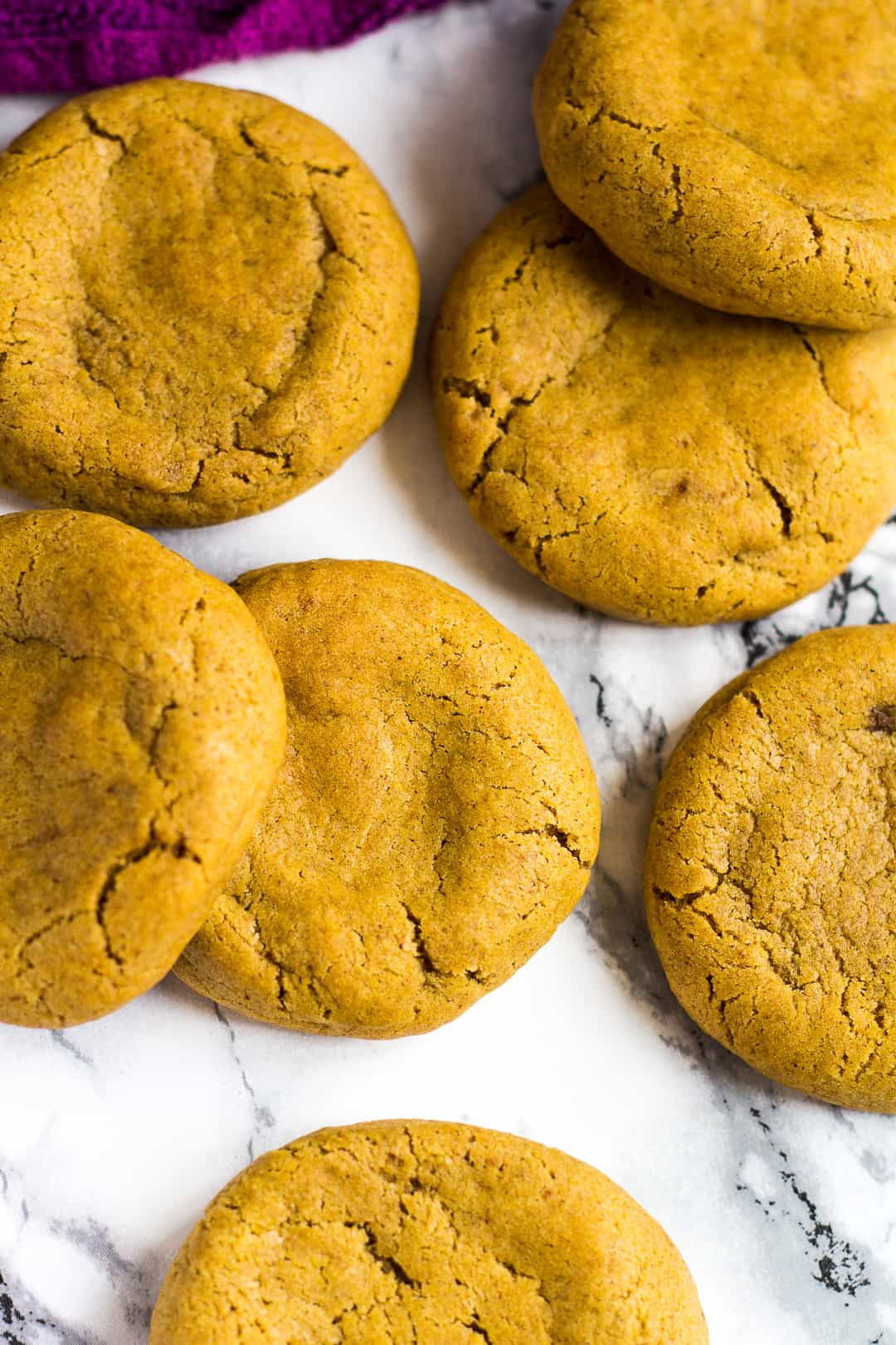 Overhead shot of pumpkin cookies with a cheesecake centre.