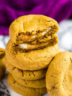 Overhead shot of a stack of cheesecake stuffed pumpkin cookies.