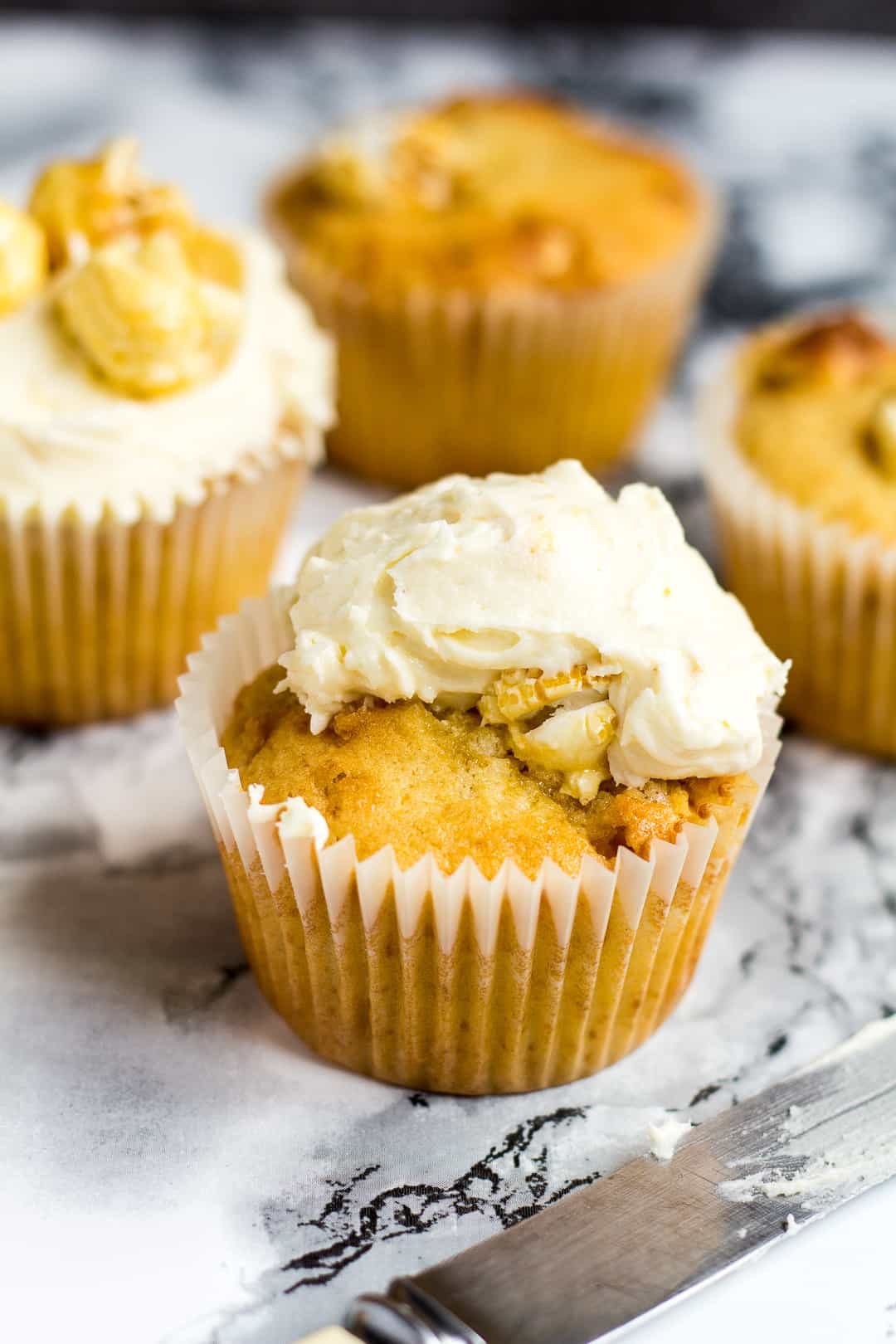 Toffee Popcorn Cupcakes- Deliciously moist and fluffy vanilla cupcakes stuffed full of toffee popcorn, and topped with a creamy buttercream frosting with popcorn bits! | marshasbakingaddiction.com | @marshasbakeblog
