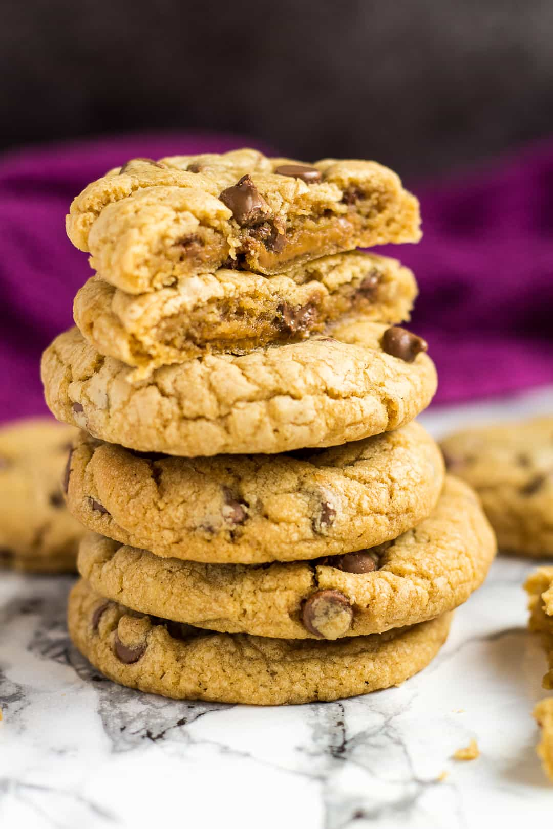 Stack of chocolate chip cookies with top cookie showing Biscoff centre.