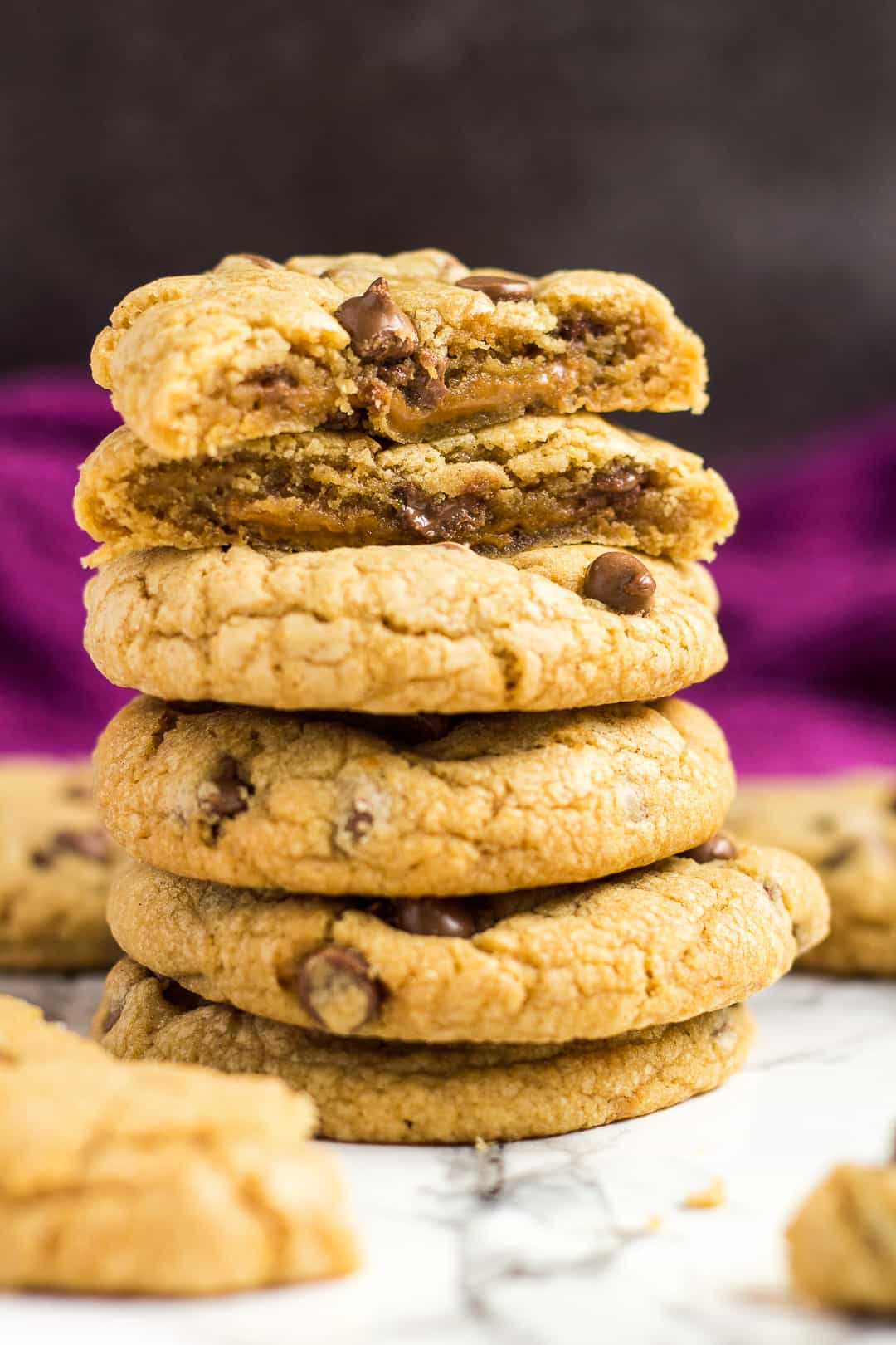 A stack of chocolate chip cookies with top cookie revealing Biscoff centre.