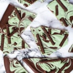 Overhead shot of mint chocolate bark broken into pieces.