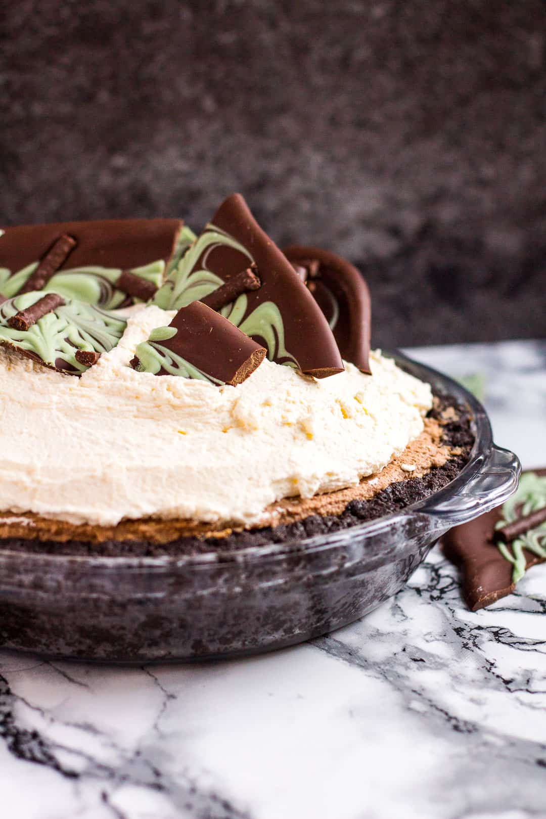 No-bake mint chocolate cream pie in a glass pie dish.