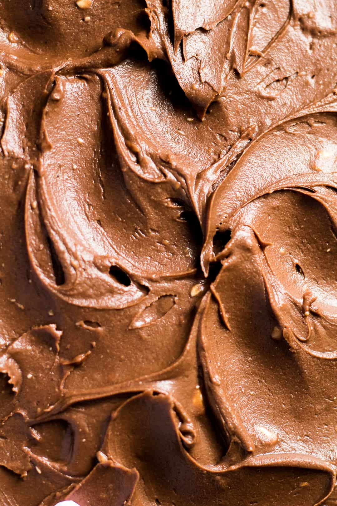 A close-up of chocolate cream cheese buttercream frosting.
