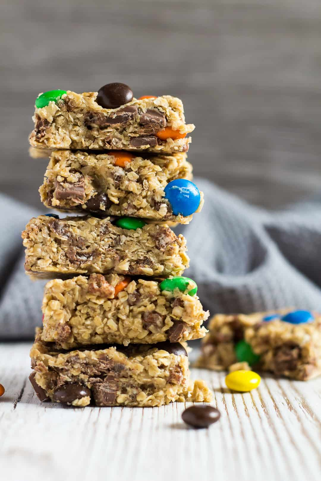 A sideview shot of a tall stack of No-Bake Peanut Butter M&M Granola Bars.
