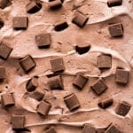 A close-up shot of creamy No-Churn Double Chocolate Ice Cream studded with chocolate chips.