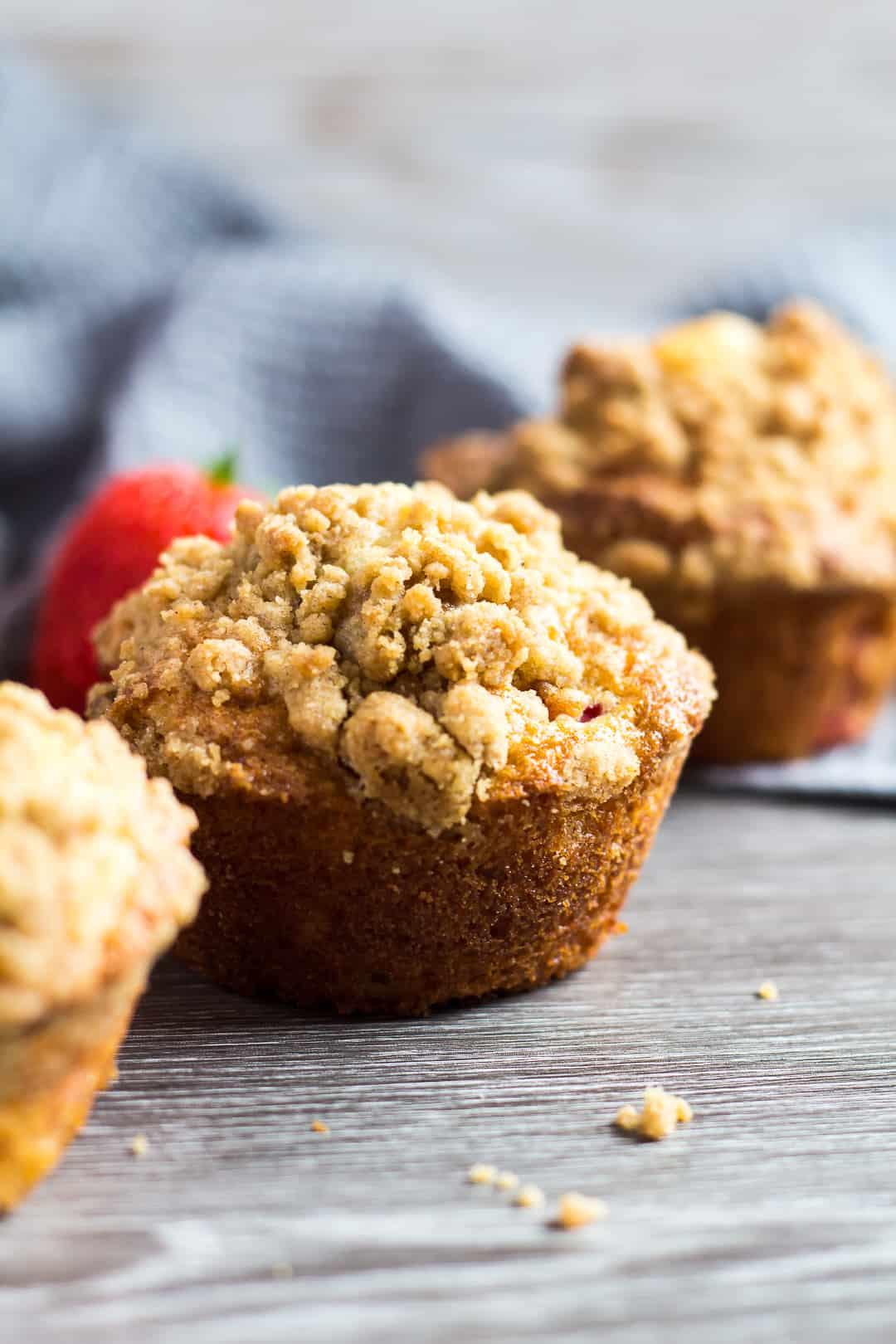 A row of three Strawberry Crumb Muffins.