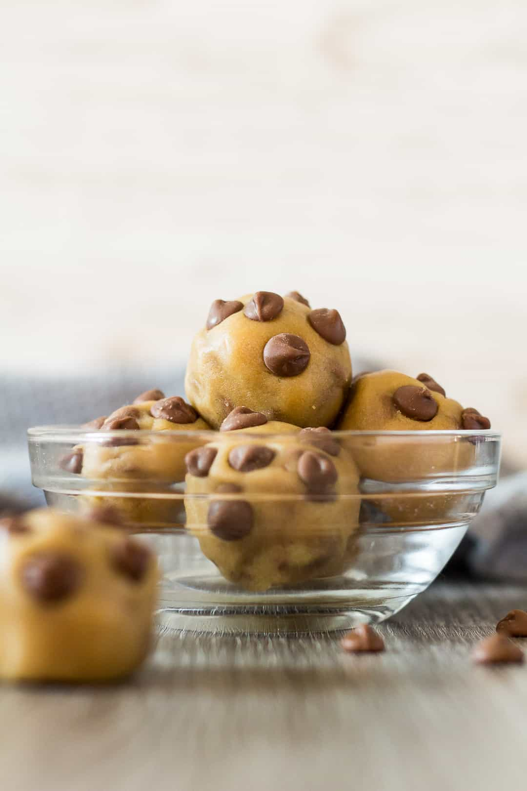 Chocolate Chip Cookie Dough Balls arranged in a small glass bowl.