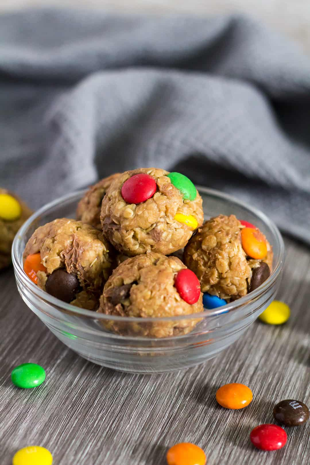 No-Bake Monster Cookie Bites arranged in a small glass bowl.