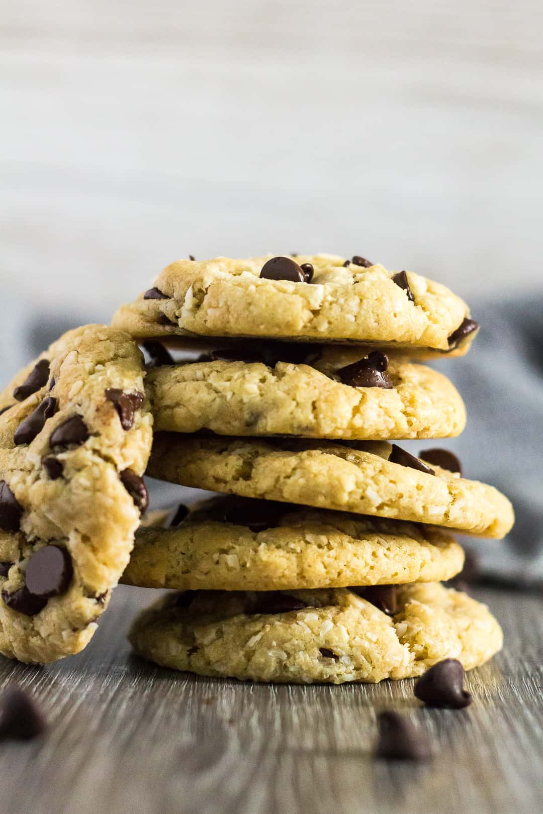 A tall stack of Coconut Chocolate Chip Cookies.