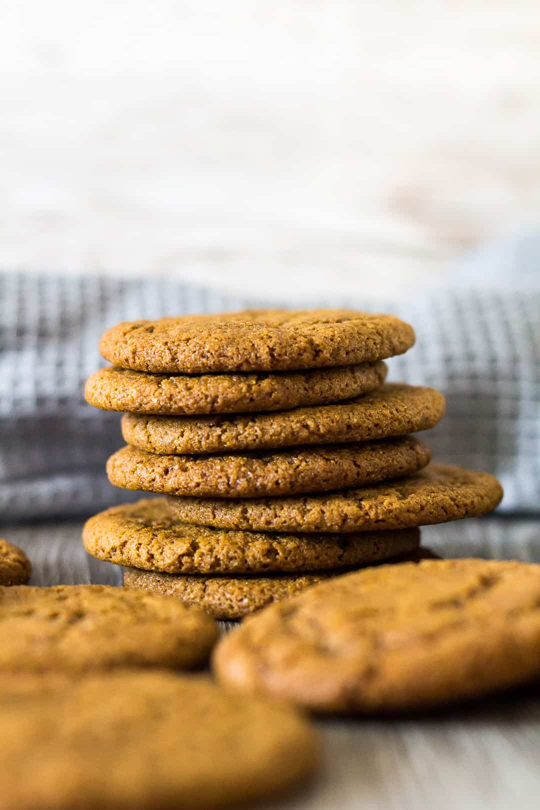 A close-up sideview of a stack of Homemade Gingernut Cookies.