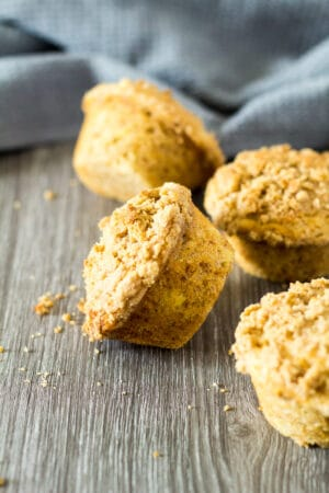 A scattered pile of Banana Crumb Muffins.