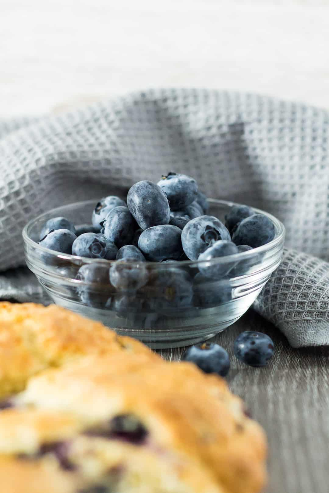 Blueberries in a small glass bowl for Blueberry Orange Scones.