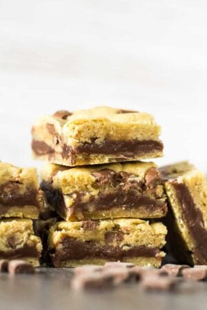 A close-up view of a stack of Fudge Stuffed Chocolate Chip Cookie Bars.