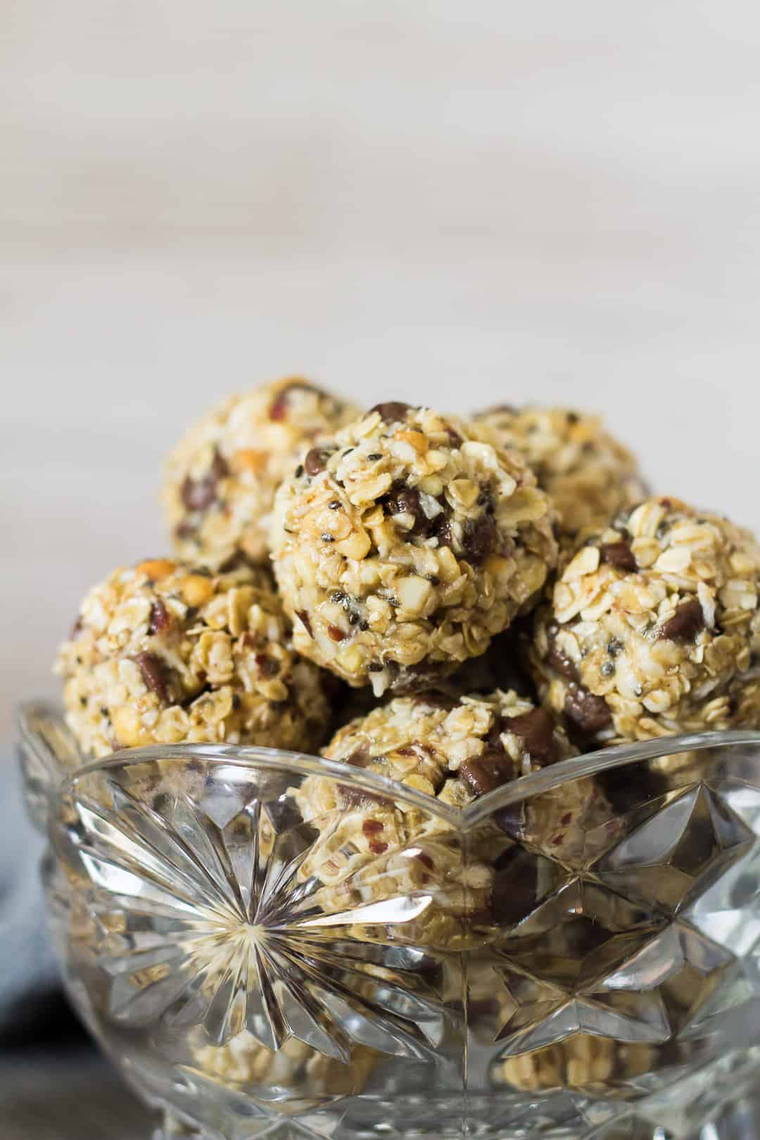 No-Bake Peanut Butter Coconut Energy Bites in a small glass bowl.