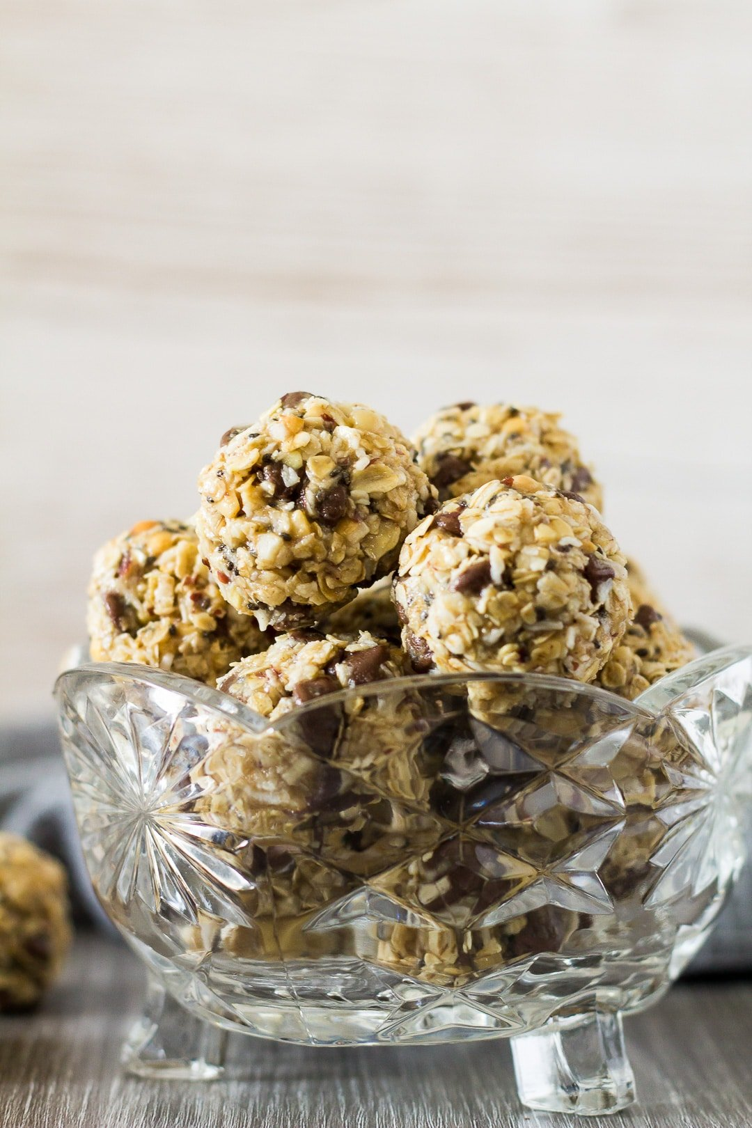 No-Bake Peanut Butter Coconut Energy Bites arranged in a small glass bowl.